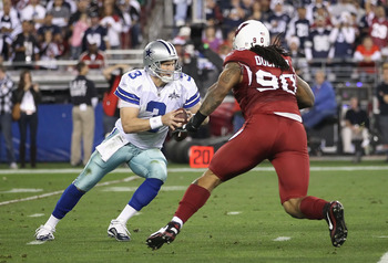 GLENDALE, AZ - DECEMBER 25:  Quarterback Jon Kitna #3 of the Dallas Cowboys is sacked by Darnell Dockett #90 of the Arizona Cardinals during the second quarter of the NFL game at the University of Phoenix Stadium on December 25, 2010 in Glendale, Arizona.
