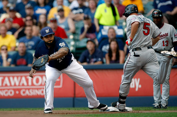 MILWAUKEE, WI - JUNE 26: Prince Fielder #28 of the Milwaukee Brewers catches the baseball for an out as Michael Cuddyer #5 of the Minnesota Twins runs at Miller Park on June 26, 2011 in Milwaukee, Wisconsin. (Photo by Scott Boehm/Getty Images)