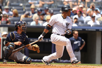 NEW YORK, NY - JUNE 30:  Robinson Cano #24 of the New York Yankees drives in two runs with a double in the first inning against the Milwaukee Brewers during their game on June 30, 2011 at Yankee Stadium in the Bronx borough of New York City.  (Photo by Al