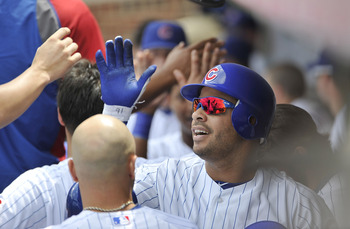 CHICAGO, IL - JUNE 27:  Aramis Ramirez #16 of the Chicago Cubs high-fives his teammates in the dugout after hitting a two-run homer scoring Starlin Castro during the first inning against the Colorado Rockies at Wrigley Field on June 27, 2011 in Chicago, I