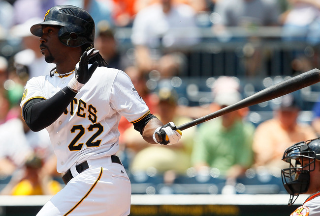 PITTSBURGH - JUNE 22:  Andrew McCutchen #22 of the Pittsburgh Pirates hits an RBI single in the first inning against the Baltimore Orioles during the game on June 22, 2011 at PNC Park in Pittsburgh, Pennsylvania.  (Photo by Jared Wickerham/Getty Images)