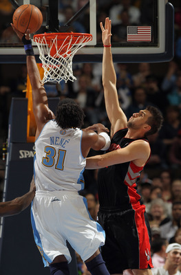 DENVER, CO - MARCH 21:  Nene #31 of the Denver Nuggets takes a shot against the defense of Andrea Bargnani #7 of the Toronto Raptors at the Pepsi Center on March 21, 2011 in Denver, Colorado. NOTE TO USER: User expressly acknowledges and agrees that, by d