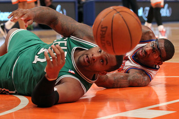 NEW YORK, NY - APRIL 24:  Glen Davis #11 of the Boston Celtics and Amar'e Stoudemire #1 of the New York Knicks reach for the ball as he bounces out of bounds in the first quarter of Game Four of the Eastern Conference Quarterfinals during the 2011 NBA Pla