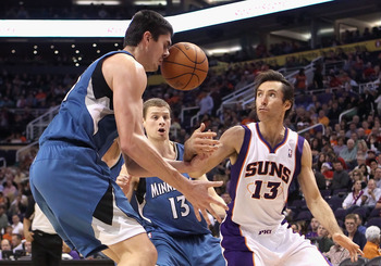 PHOENIX - DECEMBER 15:  Darko Milicic #31 of the Minnesota Timberwolves gets hit in the face by the ball as Steve Nash #13 of the Phoenix Suns loses control during the NBA game at US Airways Center on December 15, 2010 in Phoenix, Arizona. The Suns defeat