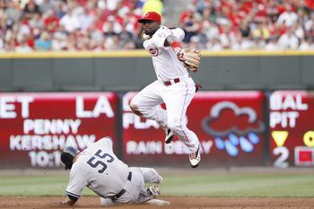 CINCINNATI, OH - JUNE 20: Brandon Phillips #4 of the Cincinnati Reds turns a double play over Russell Martin #55 of the New York Yankees at Great American Ball Park on June 20, 2011 in Cincinnati, Ohio. (Photo by Joe Robbins/Getty Images)