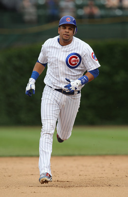 CHICAGO, IL - JULY 01: Aramis Ramirez #16 of the Chicago Cubs runs the bases after hitting the 300th home run of his career against the Chicago White Sox at Wrigley Field on July 1, 2011 in Chicago, Illinois. The White Sox defeated the Cubs 6-4. (Photo by