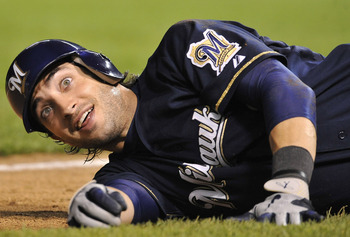 CHICAGO, IL - JUNE 15: Ryan Braun # 8 of the Milwaukee Brewers falls on the ground at third base after almost being hit by a line drive off the bat of Corey Hart during a game against the Chicago Cubs on June 15, 2011 at Wrigley Field in Chicago, Illinois