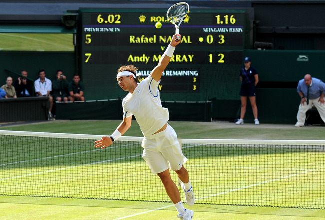 LONDON, ENGLAND - JULY 01:  Rafael Nadal of Spain in action during his semifinal round match against Andy Murray of Great Britain on Day Eleven of the Wimbledon Lawn Tennis Championships at the All England Lawn Tennis and Croquet Club on July 1, 2011 in L