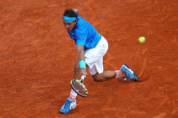 PARIS, FRANCE - JUNE 05:  Rafael Nadal of Spain hits a backhand during the men's singles final match between Rafael Nadal of Spain and Roger Federer of Switzerland on day fifteen of the French Open at Roland Garros on June 5, 2011 in Paris, France.  (Phot