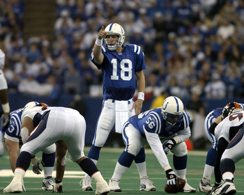 Indianapolis Colts quarterback  Peyton Manning calls a play at midfield at the RCA Dome, Indianapolis, Indiana, January 4, 2004 in an AFC wildcard playoff game.  The Colts defeated the Denver Broncos 41 - 10  (Photo by Al Messerschmidt/Getty Images)