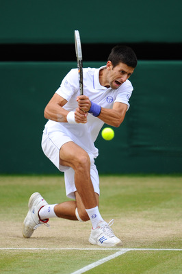 LONDON, ENGLAND - JULY 01:  Novak Djokovic of Serbia returns a shot during his semifinal round match against Jo-Wilfried Tsonga of France on Day Eleven of the Wimbledon Lawn Tennis Championships at the All England Lawn Tennis and Croquet Club on July 1, 2