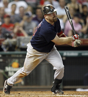 HOUSTON - JULY 01:  Kevin Youkilis #20 of the Boston Red Sox flys out to right field in the seventh inning against the Houston Astros at Minute Maid Park on July 1, 2011 in Houston, Texas.  (Photo by Bob Levey/Getty Images)