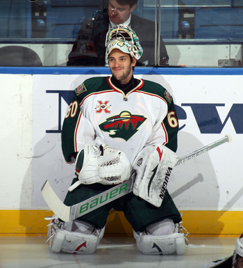 UNIONDALE, NY - MARCH 02:  Jose Theodore #60 of the Minnesota Wild tends net against the New York Islanders at the Nassau Coliseum on March 2, 2011 in Uniondale, New York. The Islanders defeated the Wild 4-1.  (Photo by Bruce Bennett/Getty Images)