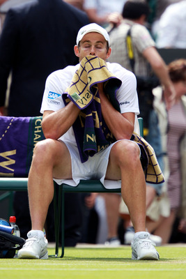 LONDON, ENGLAND - JUNE 24:  Andy Roddick of the United States wipes his face with a towel during his third round match against Feliciano Lopez of Spain on Day Five of the Wimbledon Lawn Tennis Championships at the All England Lawn Tennis and Croquet Club