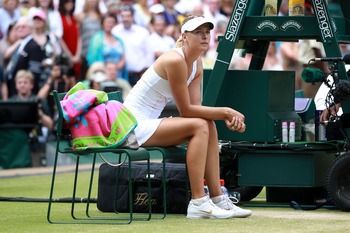 LONDON, ENGLAND - JULY 02:  Maria Sharapova of Russia reacts after losing her Ladies' final round match against Petra Kvitova of the Czech Republic on Day Twelve of the Wimbledon Lawn Tennis Championships at the All England Lawn Tennis and Croquet Club on