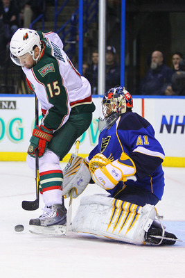 ST. LOUIS, MO - MARCH 29: Andrew Brunette #15 of the Minnesota Wild  looks to get the puck past Jaroslav Halak #41 of the St. Louis Blues at the Scottrade Center on March 29, 2011 in St. Louis, Missouri.  (Photo by Dilip Vishwanat/Getty Images)