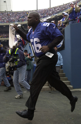 14 Jan 2001:  Lawrence Taylor, former player, of the New York Giants runs out onto the field during the NFC Championship against the Minnesota Vikings at Giants Stadium in East Rutherford, New Jersey.  The Giants beat the Vikings 41-0 to go on to the Supe