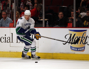 CHICAGO, IL - DECEMBER 03: Christian Ehrhoff #5 of the Vancouver Canucks skates to the puck against the Chicago Blackhawks at the United Center on December 3, 2010 in Chicago, Illinois. The Canucks defeated the Blackhawks 3-0. (Photo by Jonathan Daniel/Ge