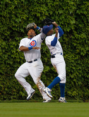 CHICAGO - MAY 12: Marlon Byrd #24 (L) and teammate Alfonso Soriano #12 of the Chicago Cubs avoid a collision in the outfield as Soriano makes the catch against the Florida Marlins at Wrigley Field on May 12, 2010 in Chicago, Illinois. (Photo by Jonathan D