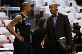 MIAMI, FL - MAY 31:  Caron Butler #4 of the Dallas Mavericks talks with Bruce Bowen of ESPN before Game One of the 2011 NBA Finals against the Miami Heat at American Airlines Arena on May 31, 2011 in Miami, Florida. Butler is on the inactive roster. NOTE