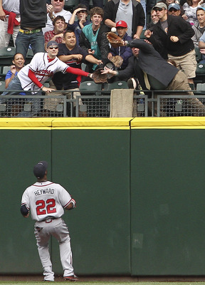 SEATTLE - JUNE 29:  Right fielder Jason Heyward #22 of the Atlanta Braves watches as a fan catches a two-run homer by Dustin Ackley #13 of the Seattle Mariners at Safeco Field on June 29, 2011 in Seattle, Washington. The Braves defeated the Mariners 5-3.