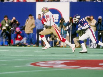 4 Jan 1987: Wide receiver Jerry Rice of the San Francisco 49ers runs down the field during a playoff game against the New York Giants at Giants Stadium in East Rutherford, New Jersey. The Giants won the game 49-3.