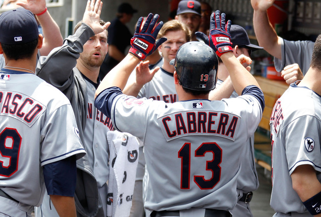 DETROIT, MI - JUNE 16: Asdrubal Cabrera #13 of the Cleveland Indians is congratulated in the dugout after scoring a first inning run while playing the Detroit Tigers at Comerica Park on June 16, 2011 in Detroit, Michigan. (Photo by Gregory Shamus/Getty Im