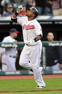 CLEVELAND, OH - JUNE 17:  Carlos Santana #41 of the Cleveland Indians celebrates after a solo home run during the fourth inning against the Pittsburgh Pirates at Progressive Field on June 17, 2011 in Cleveland, Ohio. (Photo by Jason Miller/Getty Images)