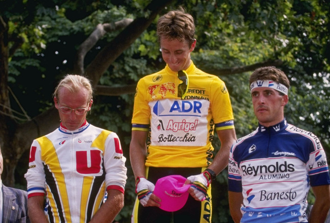 1989:  Cyclist Greg LeMond of the USA stands on top of the podium after winning the individual time trial on stage 21 of the 1989 Tour de France from Versailles to Paris. Second-placed Laurent Fignon is on the left, third-placed Pedro Delgado on the right