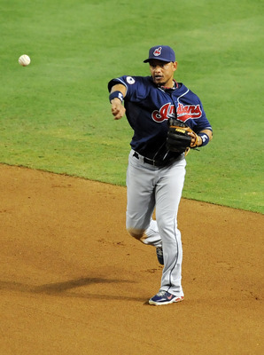 PHOENIX, AZ - JUNE 28:  Orlando Cabrera #20 of the Cleveland Indians throws the ball to first base against the Arizona Diamondbacks at Chase Field on June 28, 2011 in Phoenix, Arizona.  (Photo by Norm Hall/Getty Images)