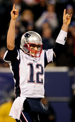 EAST RUTHERFORD, NJ - DECEMBER 29:  Tom Brady #12 and the New England Patriots celebrates after throwing his 49th touchdown of the season tying the all time season high for touchdowns in a season against the New York Giants on December 29, 2007 at Giants