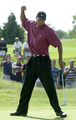 10 Dec 2000:  Tiger Woods celebrates a birdie on the 11th hole during the final round of the World Cup of Golf at the Buenos Aires Golf Club in Buenos Aires, Argentina. The USA went on to win the tournament.  DIGITAL IMAGE. Mandatory Credit: Harry How/ALL