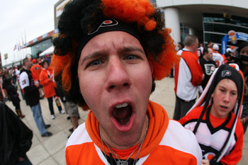 PHILADELPHIA, PA - APRIL 22:  A Philadelphia Flyers fan arrives for their game against the Buffalo Sabres prior to Game Five of the Eastern Conference Quarterfinals during the 2011 NHL Stanley Cup Playoffs at Wells Fargo Center on April 22, 2011 in Philad