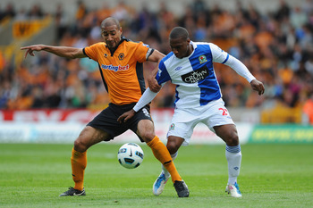 WOLVERHAMPTON, ENGLAND - MAY 22: David Hoilett of Blackburn in action with Karl Henry of Wolves during the Barclays Premier League match between Wolverhampton Wanderers and Blackburn Rovers at Molineux on May 22, 2011 in Wolverhampton, England.  (Photo by