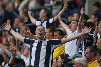 WEST BROMWICH, UNITED KINGDOM - AUGUST 23:  West Bromwich fans attempt to rally their team during the Barclays Premier League match between West Bromwich Albion and Everton at the Hawthorns on August 23, 2008 in West Bromwich, England.  (Photo by Hamish B