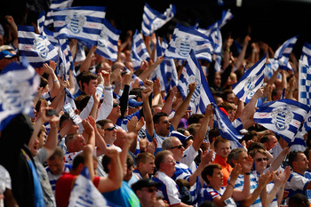 LONDON, ENGLAND - MAY 07:  QPR fans celebrate with their flags as the final whistle approaches during the npower Championship match between Queens Park Rangers and Leeds United at Loftus Road on May 7, 2011 in London, England.  (Photo by Dan Istitene/Gett
