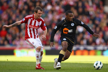 STOKE ON TRENT, ENGLAND - MAY 22: Charles N'Zogbia of Wigan battles for the ball with Glenn Whelan of Stoke during the Barclays Premier League match between Stoke City and Wigan Athletic at Britannia Stadium on May 22, 2011 in Stoke on Trent, England.  (P
