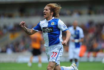 WOLVERHAMPTON, ENGLAND - MAY 22: Michel Salgado of Blackburn celebrates their opening goal during the Barclays Premier League match between Wolverhampton Wanderers and Blackburn Rovers at Molineux on May 22, 2011 in Wolverhampton, England.  (Photo by Mich