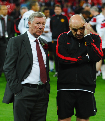 LONDON, ENGLAND - MAY 28:  Sir Alex Ferguson manager of Manchester United (L) and Mike Phelan assistant manager of Manchester United show their dejection after the UEFA Champions League final between FC Barcelona and Manchester United FC at Wembley Stadiu