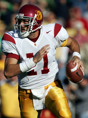SOUTH BEND, IN - OCTOBER 15:  Quarterback Matt Leinart #11 of the University of Southern California Trojans rolls out and looks for a receiver against the Notre Dame Fighting Irish on October 15, 2005 at Notre Dame Stadium in South Bend, Indiana.  (Photo