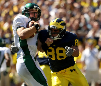 ANN ARBOR, MI - SEPTEMBER 19: Linebacker Craig Roh #88 of the Michigan Wolverines sacks quarterback Andy Schmitt #7 of the Eastern Michigan Eagles at Michigan Stadium on September 19, 2009 in Ann Arbor, Michigan.  Michigan won 45-17.  (Photo by Stephen Du