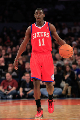 NEW YORK, NY - FEBRUARY 06:  Jrue Holiday #11 of the Philadelphia 76ers dribbles the ball against the New York Knicks at Madison Square Garden on February 6, 2011 in New York City. NOTE TO USER: User expressly acknowledges and agrees that, by downloading