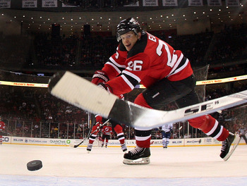 NEWARK, NJ - APRIL 06: Patrik Elias #26 of the New Jersey Devils scores an empty net goal past an outstretched stick against the Toronto Maple Leafs  at the Prudential Center on April 6, 2011 in Newark, New Jersey. The Devils defeated the Maple Leafs 4-2.