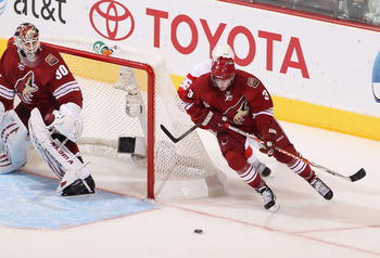 GLENDALE, AZ - APRIL 18:  Keith Yandle #3 of the Phoenix Coyotes skates with the puck in Game Three of the Western Conference Quarterfinals against the Detroit Red Wings during the 2011 NHL Stanley Cup Playoffs at Jobing.com Arena on April 18, 2011 in Gle