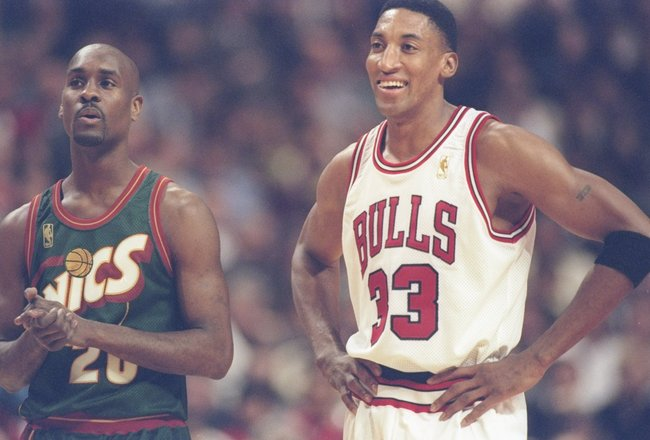 18 Mar 1997:  Forward Scottie Pippen (right) of the Chicago Bulls and guard Gary Payton of the Seattle Supersonics stand during a break in the game at the United Center in Chicago, Illinois.  The Bulls won the game 89 - 87. Mandatory Credit: Jonathan Dani