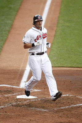 CLEVELAND, OH - JUNE 22:  Travis Buck #28 of the Cleveland Indians scores the first run during the game against the Colorado Rockies on June 22, 2011 at Progressive Field in Cleveland, Ohio.  The Cleveland Indians defeated the Colorado Rockies 4-3. (Photo