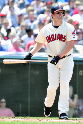CLEVELAND, OH - JUNE 5: Austin Kearns #26 of the Cleveland Indians reacts after a strike during the third inning against the Texas Rangers at Progressive Field on June 5, 2011 in Cleveland, Ohio. (Photo by Jason Miller/Getty Images)