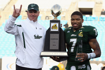 CHARLOTTE, NC - DECEMBER 31:  Head coach Skip Holtz stands with MVP B.J. Daniels #7 of the USF Bulls after a 31-26 victory over the Clemson Tigers at Bank of America Stadium on December 31, 2010 in Charlotte, North Carolina.  (Photo by Streeter Lecka/Gett