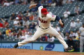 CLEVELAND, OH - JUNE 19: Joe Smith #38 of the Cleveland Indians pitches against the Pittsburgh Pirates during their game on June 19, 2011 at Progressive Field in Cleveland, Ohio.  The Indians defeated the Pirates 5-2 in 11 innings.  (Photo by David Maxwel