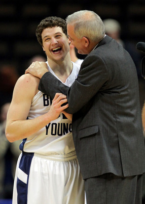 DENVER, CO - MARCH 19:  Jimmer Fredette #32 celebrates with head coach Dave Rose of the Brigham Young Cougars after defeating the Gonzaga Bulldogs during the third round of the 2011 NCAA men's basketball tournament at Pepsi Center on March 19, 2011 in Den